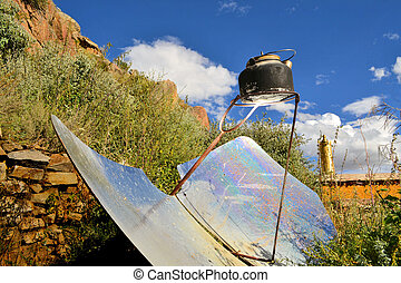 tea kettle boiling by solar parabolic reflector - A kettle...