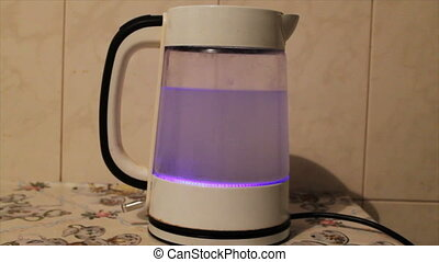 Tea kettle with boiling water. Water boiling in kettle - Tea...