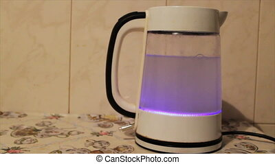 Tea kettle with boiling water. Water boiling in kettle