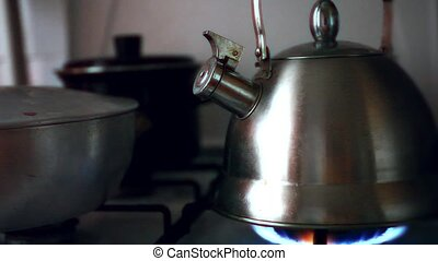 Tea Kettle with Steam Over A Hot Gas Stove. HD. 1920x1080