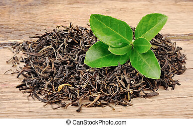 Tea leaves on a wooden tables