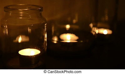 Tea Light Candles - Small tea light candles burning in glass...