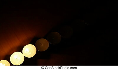 Tea lights are lit in the night
