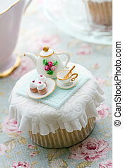 Tea party cupcake - Cupcake decorated with a tiny fondant...