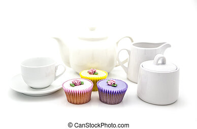 Tea party with cup cakes on white background