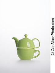 Tea pot set or Porcelain tea pot and cup on background.
