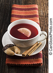 Red hot tea with cookies close up shoot
