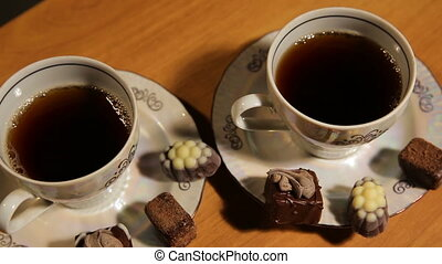 Tea set on the table with chocolate candy. - Chocolate ...