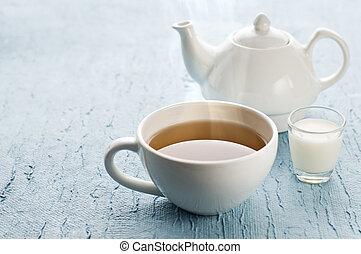 Tea - Cup of hot tea with milk close up shoot