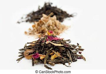 Tea - An image of three heaps of various tea