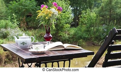 Tea table with a book