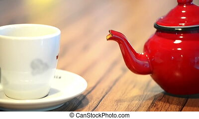 Tea Time - Close up of a teapot pouring tea