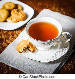 Tea With Cookies On Wooden Background