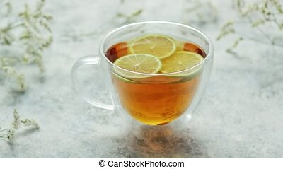 Tea with lemon in cup - From above view of glass mug with...