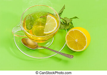 Tea with mint and lemon in glass cup