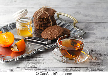 tea with oat cookies on tray