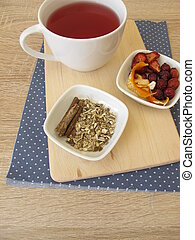 Tea with with dried strawberries, rose hips, orange peel and...