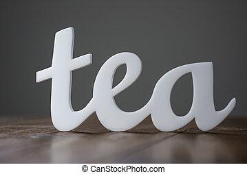 Tea Word on Wooden Table