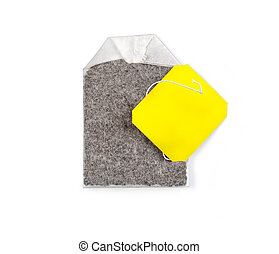 Teabag with yellow label.