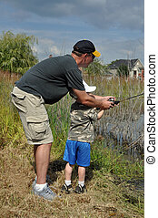 teach a boy to fish - a father teaches his son to fish