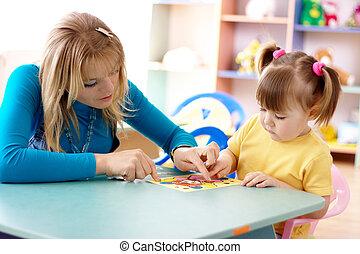 Teacher and child in preschool