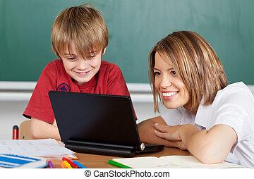 Teacher and laptop
