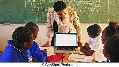 Teacher and pupils with laptop in class 4k - Front view of a...