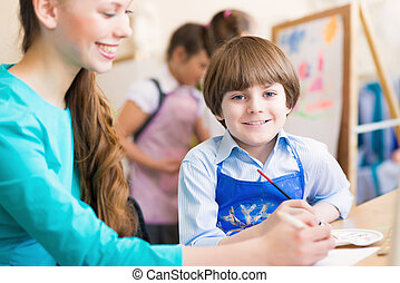 teacher and student in the classroom - teacher deals with a...