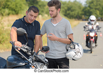teacher and student on a motorbike test