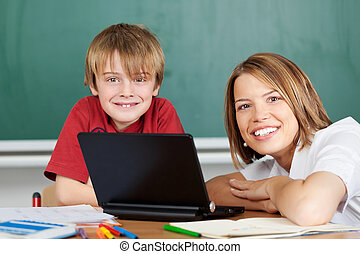 Teacher and student with laptop