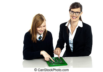 Teacher and student working on calculator
