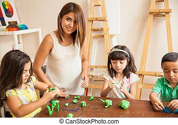 Teacher and students during art class