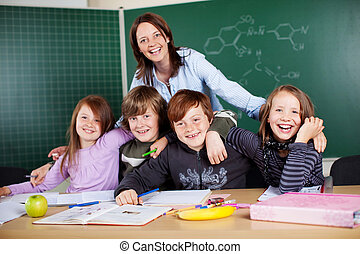 Teacher and students - Portrait of happy teacher and her...