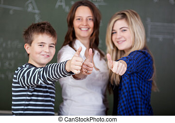 Teacher and students with thumbs up