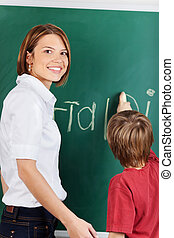Teacher and young student