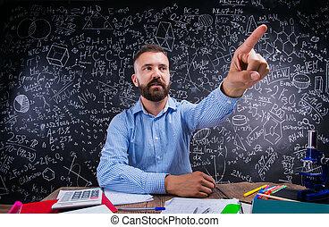 Teacher at desk, school supplies, raised finger, big...