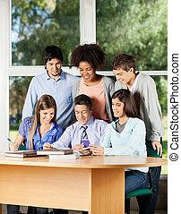 Teacher Explaining Students In Classroom