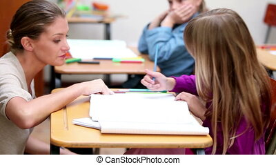 Teacher giving explanations to a pupil
