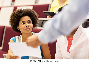 teacher giving test to student girl on lecture