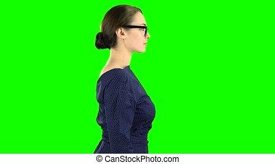 Teacher goes to class. Green screen. Side view - Teacher in...