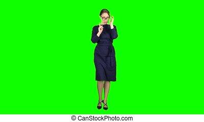Teacher goes to class. Green screen - Teacher in a long...