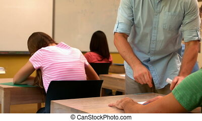 Teacher helping a student in class