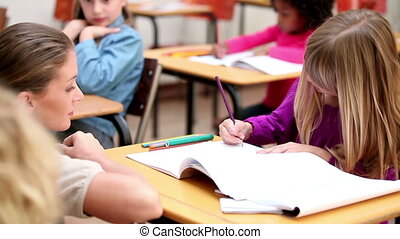 Teacher helping her pupil