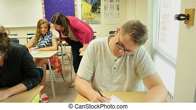 Teacher helping students UHD 4k