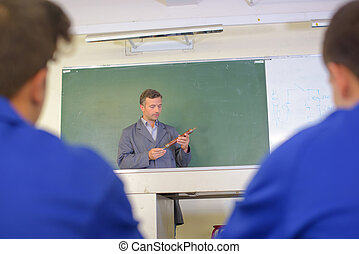 Teacher in front of blackboard