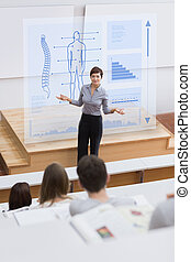 Teacher in front of futuristic interface asking a question