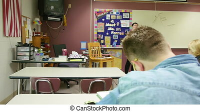 Teacher lecturing students and teac - A high school teacher...