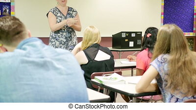 Teacher lecturing students and teac