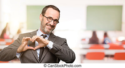 Teacher man using glasses happy showing love with hands in heart shape expressing healthy and marriage symbol