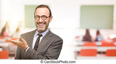 Teacher man using glasses holding something in empty hand
